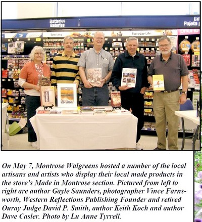 Picture in Montrose Mirror of book signing at Walgreens.